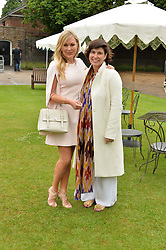 Left to right, FLEUR COOPER and SOPHIE LILLINGSTON at the Goffs London Sale held at The Orangery, Kensington Palace, London on 12th June 2016.