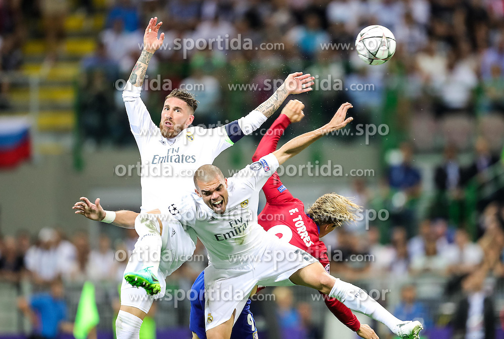 Sergio Ramos of Real Madrid, Pepe of Real Madrid vs Fernando Torres of Atlético during football match between Real Madrid (ESP) and Atlético de Madrid (ESP) in Final of UEFA Champions League 2016, on May 28, 2016 in San Siro Stadium, Milan, Italy. Photo by Vid Ponikvar / Sportida