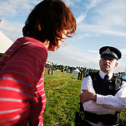Climate Camp UK 2007<br /> Police went on site early Monday morning to force on an agreement with the climate change activists, to allowe a permanent presence of at least 4 police officers.  The Climate Camp is a camp set up to highlight protests against a proposed third runway at Heathrow, destroying nearby villages and to put the spotlight on climate change issues.