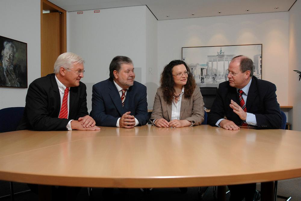 21 MAY 2007, BERLIN/GERMANY:<br /> Frank-Walter Steinmeier, SPD, Bundesaussenminister, Kurt Beck, SPD Parteivorsitzender, Andrea Nahles, MdB, SPD, Vorsitzende des Forums Demokratische Linke 21, Peer Steinbrueck, SPD, Bundesfinanzminister, (v.L.n.R.), vor einem gemeinsamen Gespraech, vor der Vorstellung der drei Kandidaten fuer den Posten des Stellvertretenden Parteivorsitzenden in den SPD-Gremien durch Beck, Buero des Parteivorsitzenden, Willy-Brandt-Haus<br /> IMAGE: 20070521-01-035<br /> KEYWORDS: Peer Steinbrück, Stellvertreter, Gruppe, Gruppenfoto, Gruppenbild, Gespräch