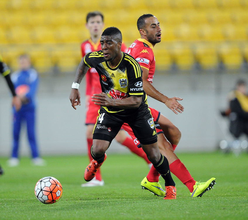 Phoenix's Rolieny Bonevacia, left, runs pass Adelaide United's Sergio Cirio in the A-League football match at Westpac Stadium, Wellington, New Zealand, Friday, November 13, 2015. Credit:SNPA / Ross Setford