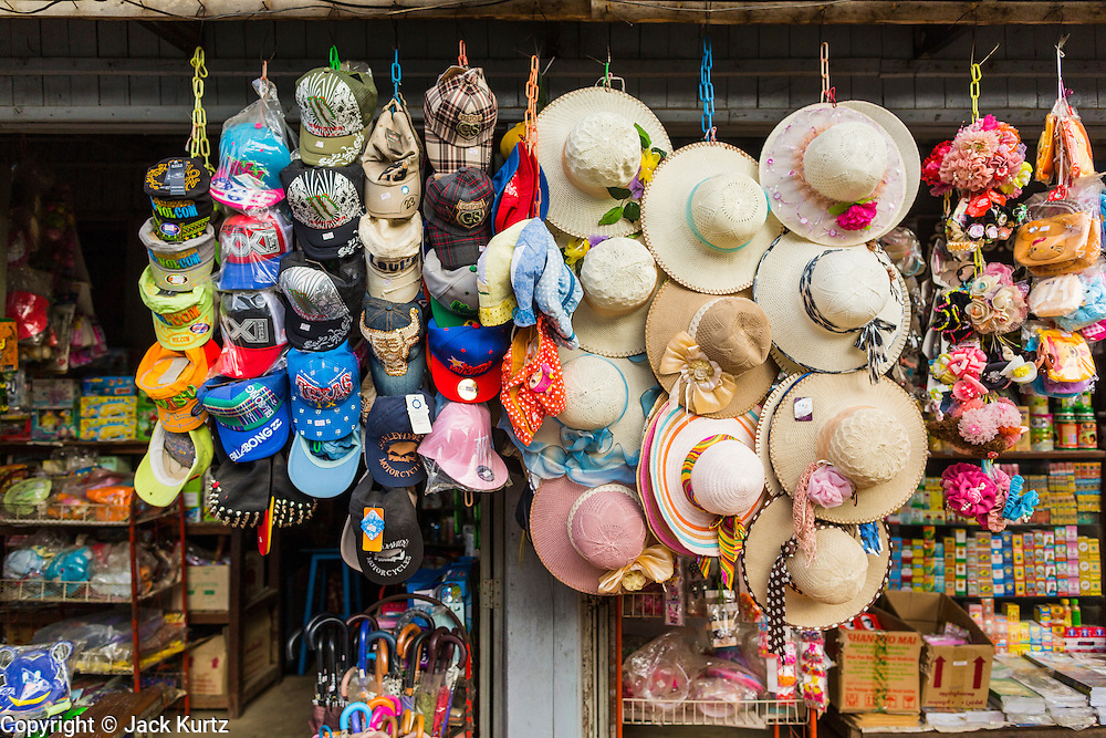 06 JUNE 2014 - IRRAWADDY DELTA,  AYEYARWADY REGION, MYANMAR: Hats for sale in a shop in Pantanaw, a town in the Irrawaddy Delta (or Ayeyarwady Delta) in Myanmar. The region is Myanmar's largest rice producer, so its infrastructure of road transportation has been greatly developed during the 1990s and 2000s. Two thirds of the total arable land is under rice cultivation with a yield of about 2,000-2,500 kg per hectare. FIshing and aquaculture are also important economically. Because of the number of rivers and canals that crisscross the Delta, steamship service is widely available.   PHOTO BY JACK KURTZ