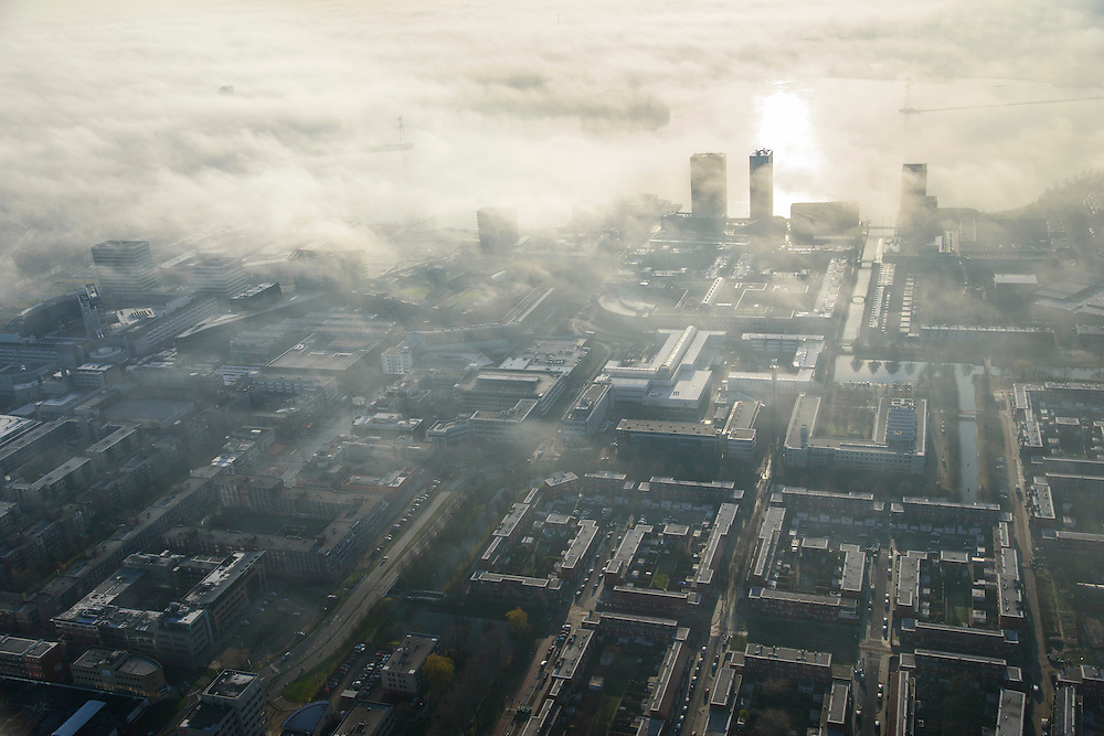 Nederland, Flevoland, Almere, 11-12-2013; Stadshart van Almere in de mist, de hoogbouw aan het Weerwater steekt net boven de wolken uit.<br /> Heart of the newly constructed city of Almere in the fog and backlighted.<br /> luchtfoto (toeslag op standaard tarieven);<br /> aerial photo (additional fee required);<br /> copyright foto/photo Siebe Swart.