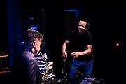 Savion Glover tap dancing while a 13 year old accompanies him on saxophone.