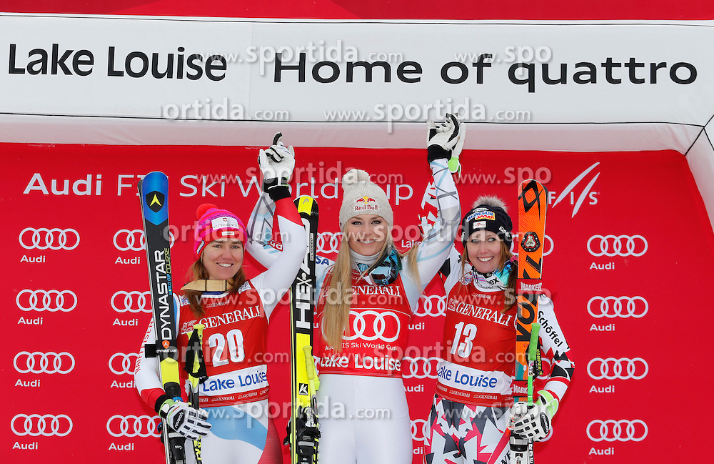 05.12.2015, East Summit Course, Lake Luise, CAN, FIS Weltcup Ski Alpin, Lake Luise, Damen, Abfahrt, Rennen, im Bild v.l. Fabienne Suter (SUI, 2. Platz), Lindsey Vonn (USA, 1. Platz), Cornelia Huetter (AUT, 3. Platz) // 2nd placed Fabienne Suter of Switzerland ( L ), winner Lindsey Vonn of the USA ( C ) and 3rd placed Cornelia Huetter of Austria during the race of ladies downhill of the Lake Luise FIS Ski Alpine World Cup at the East Summit Course in Lake Luise, Canada on 2015/12/05. EXPA Pictures &copy; 2015, PhotoCredit: EXPA/ SM<br /> <br /> *****ATTENTION - OUT of GER*****