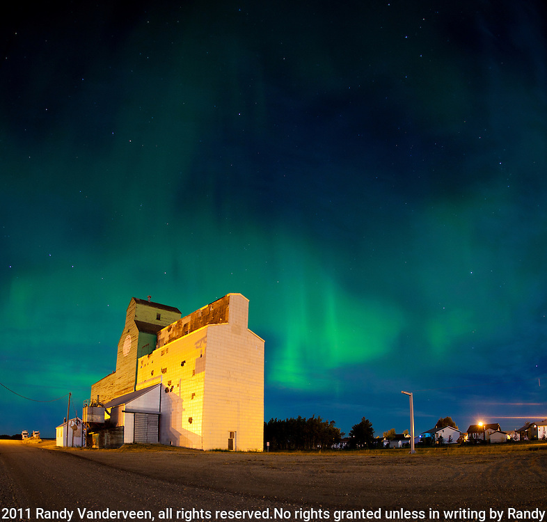 "Photo Randy Vanderveen.Sexsmith, Alberta.The northern lights fill the skies above one of the elevators standing in the town of Sexsmith. The ""Prairie Sentinels"" are rapidly disappearing across the west as they are replaced by concrete and metal terminals."