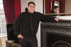 Antony Zomparelli in his sitting room in the Georgian flat he bought through Right-To-Buy in 2014, and has now been asked to pay more than twice the price after the council mistakenly sold it to him as a one bedroom flat, a small 8ft x 8ft box room being considered a second bedroom. London, February 04 2019.