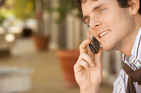 Man using mobile phone outdoors close-up