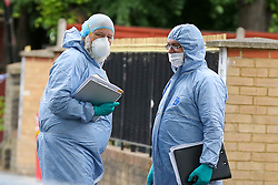 © Licensed to London News Pictures. 28/05/2019. London, UK. Forensic officers on Romford Road, Forest Gate, East London where a man in his 30s died in the early hours of this morning following a flight on Warwick Road.<br />