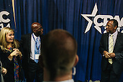 Abigail Frye, left, from Georgia, is escorted to meet Dr. Ben Carson, right, during a meet and greet with him on the final day of the Conservative Political Action Conference (CPAC) at the Gaylord National Resort & Convention Center in National Harbor, Md.