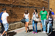 Young students strolling in Calle Sacramento in Leon, Castilla y Leon, Spain