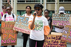 London, UK. 10 July, 2019. Susan, a victim of the fast track deportation system from Uganda, addresses campaigners from groups including Movement for Justice and Out and Proud protesting outside the Home Office against the government department's decision to try to block the return to the UK of PN, a Ugandan lesbian removed from the UK using the now unlawful fast track procedure in 2013 but who the High Court ordered on 24th June must be returned to the UK by the Home Office after the handling of her case was ruled to be 'procedurally unfair'.