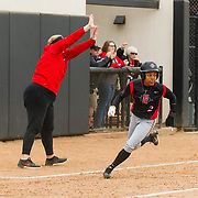 12 May 2018: San Diego State outfielder Zaria Meshack rounds third base and scores putting the Aztecs up 2-1. San Diego State women's softball closed out the season against Utah State with a 4-3 win on seniors day and sweep the series. <br /> More game action at sdsuaztecphotos.com