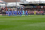 Match officials and players from both teams hold a minutes applause before kick off in memory of the late Ray Wilkins during the EFL Sky Bet Championship match between Brentford and Ipswich Town at Griffin Park, London, England on 7 April 2018. Picture by Andy Walter.