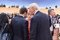 07 JUL 2017, HAMBURG/GERMANY:<br /> Emmanuel Macron (L), Praesident Frankreich, Angela Merkel (M), CDU, Bundeskanzlerin, und Donald Trump (R), Praesident Vereinigte Staatsn von America, USA, im Gesprech, vor Beginn der 1. Arbeitssitzung, G20 Gipfel, Messe<br /> IMAGE: 20170707-01-046<br /> KEYWORDS: G20 Summit, Deutschland, Gespr&auml;ch