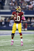 Washington Redskins quarterback Robert Griffin III (10) drops back to pass during the NFL week 6 football game against the Dallas Cowboys on Sunday, Oct. 13, 2013 in Arlington, Texas. The Cowboys won the game 31-16. ©Paul Anthony Spinelli
