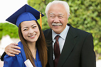 Graduate and Grandfather outside portrait