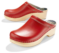 Red clogs on white background
