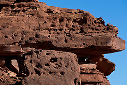 Sandstone cliff wall with holes, Capitol Reef National Park, Utah, United States of America
