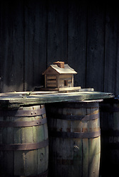Design image rain water barrels and miniature log cabin house