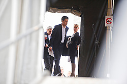 © London News Pictures. 20/10/2012. London, UK. Labour Leader Ed Miliband entering the stage after delivering a speech at a TUC (Trades Union Congress) rally in Hyde Park, London on October 20, 2012. Photo credit : Ben Cawthra /LNP
