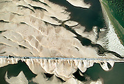 Sand forms sediment around a stone jetty on the Mississippi River.  The river moves about 500 million tons of sediment into the Gulf of Mexico every year.