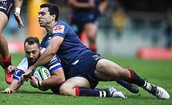 Cape Town-180427 Stomers Dewaldt tackled by Adam Coleman of the Rebels in the Super 15 rugby game at Newlands Stadium.photograph:Phando Jikelo/African news Agency