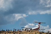 August 23, 2017<br /> Onlookers watch a fixed wing firefighting plane as the Mogul Fire burns in northwest Reno, Nevada, on Wednesday, August 23, 2017. Reports from the Truckee Meadows Fire department, at approximately 4:30 pm, state the fire has burned 120 acres and 10 homes have been evacuated. There has been one heat-related injury. The cause of the fire has not been determined at this time.