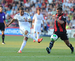 Bournemouth's Steve cook tries to stop a shot from Real Madrid's Karim Bensema  - Photo mandatory by-line: Alex James/JMP  - Tel: Mobile:07966 386802 20/07/2013 -Bournemouth vs Real Madrid  - SPORT - FOOTBALL -  Dean Court-Bournemouth - Real Madrid -