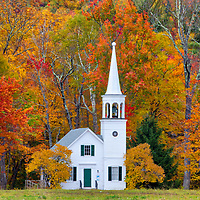 This New England fall foliage season I traveled up north to photograph New Hampshire fall foliage and waterfalls. My journey brought me to the iconic New England Wonalancet Union Church in Tamworth, NH. It was my first visit and approaching the location just blew me away. I quickly pulled over and explored certain perspectives and in this image made my way into the field. I loved how this classic New England Photography subject was framed by the colorful fall foliage. <br />