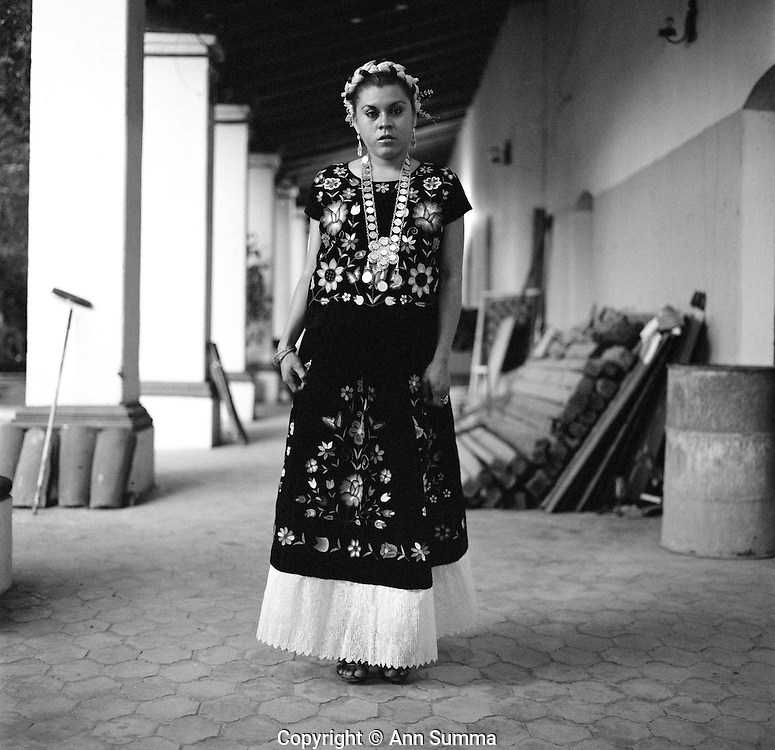 Juchitan, Mexico: Simonetta (Jose de Jesus Molina) at the Juchitan Cultural Center in a traditional dress she rented for $50.00. Muxes are very common, and accepted, in this Southern Oaxacan region, which claims to not discriminate against gays. The matriarchal society is still driven by women but in flux in the machismo culture of Mexico. (photo: Ann Summa).