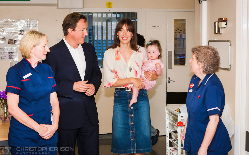 Prime Minister David Cameron and his wife Samantha return to the Princess Alexandra Maternity Unit in Truro with daughter Florence at thank the staff on the baby's first birthday.