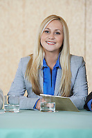 Business woman smiling in conference, portrait