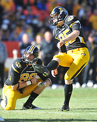 Nov 27, 2010; Kansas City, MO, USA; Missouri Tigers kicker Grant Ressel (95) kicks the point after as wide receiver Forrest Shock (88) holds in the first half of the game against the Kansas Jayhawks at Arrowhead Stadium. Missouri won 35-7.  Mandatory Credit: Denny Medley-US PRESSWIRE