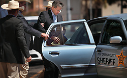 "Texas Rangers escort polygamist leader Warren Jeffs, who heads the Fundamentalist Church of Jesus Christ of Latter-Day Saints, after he was sentenced to life in prison for sexually assaulting two underage girls he claimed as ""spiritual"" brides. The Texas jury of ten women and two men deliberated for less than an hour before giving him a life sentence for one charge and 20 years for a second, the maximum sentence for both. San Angelo, Texas, Aug. 9, 2011."
