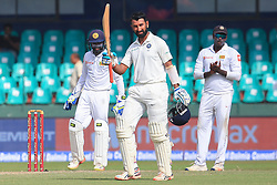 August 3, 2017 - Colombo, Sri Lanka - Indian cricketer Cheteshwar Pujara(M) raises his bat after scoring a hundred during the 1st Day's play in the 2nd Test match between Sri Lanka and India at the SSC international cricket stadium at the capital city of Colombo, Sri Lanka on Thursday 03 August 2017. (Credit Image: © Tharaka Basnayaka/NurPhoto via ZUMA Press)