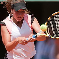 31 May 2009: Aravane Rezai of France hits a backhand during the Women's Singles fourth round match on day eight of the French Open at Roland Garros in Paris, France.