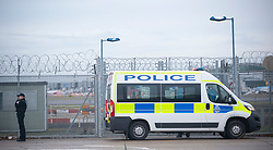 © Licensed to London News Pictures. 20/12/2018. Gatwick, UK. Police at Perimeter fence, Drone has closed Gatwick airport with all flights in and out cancelled while police hunt for drone pilot deliberately targeting airport.Photo credit: Grant Falvey/LNP