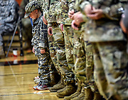 Five-year-old Oscar Bruce, son of Lt. Col. Trent Bruce, of Sioux Falls, stands with his dad as the commanding officers during the Reading of the Order part of the 153rd Engineer Battalion deactivation ceremony on Saturday morning at the Huron Arena. (Matt Gade / Republic)