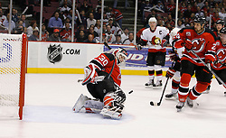 April 26, 2007; East Rutherford, NJ, USA; New Jersey Devils goalie Martin Brodeur (30) makes a save during the second period at Continental Airlines Arena in East Rutherford, NJ.