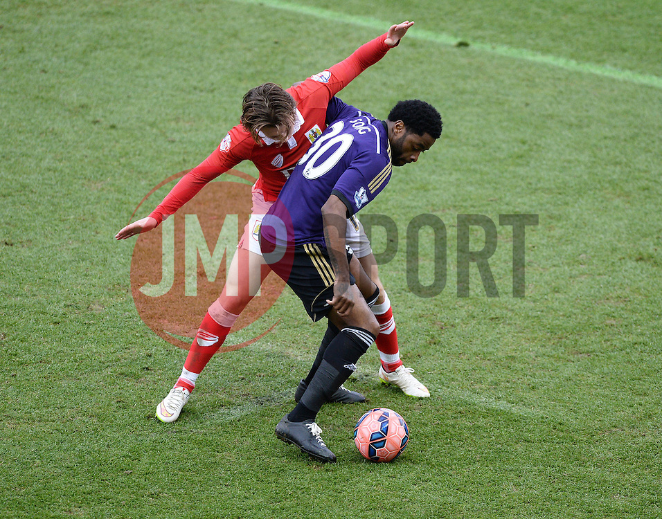 West Ham's Alexandre Song shields the ball from Bristol City's Luke Freeman - Photo mandatory by-line: Alex James/JMP - Mobile: 07966 386802 - 25/01/2015 - SPORT - Football - Bristol - Ashton Gate - Bristol City v West Ham United - FA Cup Fourth Round