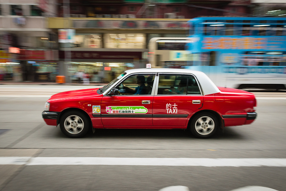 Hong Kong taxi in motion in Central