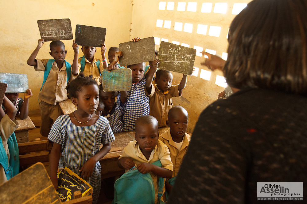 Beatrice Aka Affoue teaches a CP1 class basic maths in the town of Faye, Bas-Sassandra region, Cote d'Ivoire on Monday March 5, 2012. The class has 79 students, and the school has been forced to refuse any additional students.