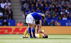 Chelsea's Eden Hazard on the ground after picking up an injury during the Premier League match at the King Power Stadium, Leicester.