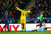 Manchester City goalkeeper Ederson Moraes (31) gestures for immediate attention for Manchester City defender John Stones (5) during the Premier League match between Leicester City and Manchester City at the King Power Stadium, Leicester, England on 18 November 2017. Photo by John Potts.