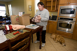 Homeowner packs up belongings in his kitchen to move into storage in Vallejo, Calif., He  lost their home in 2009 to foreclosure due to a combination of job loss, adjustable loan payments doubling and  home value under water nearly fifty percent. Photo by Kim Kulish