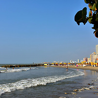 """Beach Facing Caribbean in Bocagrande, Cartagena, Colombia <br /> If """"Caribbean Beach"""" conjures up images of secluded white sand beneath swaying palm trees, then you will be disappointed in the Bocagrande beach facing the Caribe.  It resembles a gritty Miami Beach.  The narrow shore in the shadow of endless high-rises is jammed with tourists and hawkers. The waves are rough despite rings of breakwaters.  Yet it is close to the new major hotels so it is convenient for a quick dip or tanning in the sunshine."""