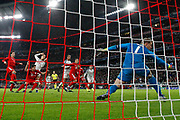 GOAL 1-2 Liverpool defender Virgil van Dijk (4) jumps high to head in Liverpool's second during the Champions League match between Bayern Munich and Liverpool at the Allianz Arena, Munich, Germany, on 13 March 2019.