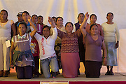 Local women from Tlamanca receive an ovation from the hundreds of participants in the 2014 Mexican Network of Mining-Affected Peoples (REMA, for its initials in Spanish) Encounter. The local women were thanked for their hospitality in preparing all the meals, and honored for spearheading the local struggle against JDC Minerals, a Chinese mining firm. Hundreds of people from mining-affected communities throughout Mexico gathered for three days to exchange experiences, renew alliances and discuss strategies. Tlamanca, Zautla, Puebla, México. March 16, 2014.