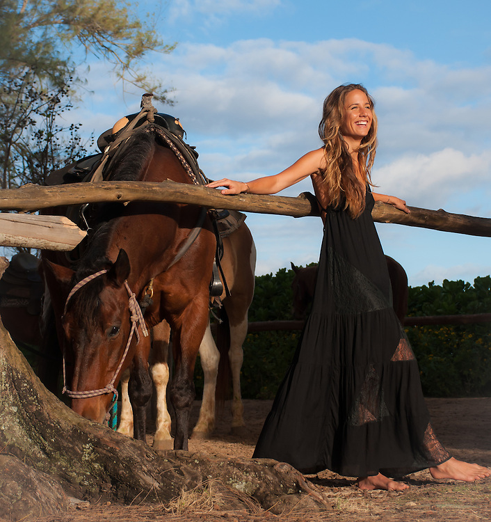 Woman with horse in Tiare Hawaii Lanai Dress in Black<br />